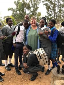 photo of Dr. Ritter and students in Zimbabwe